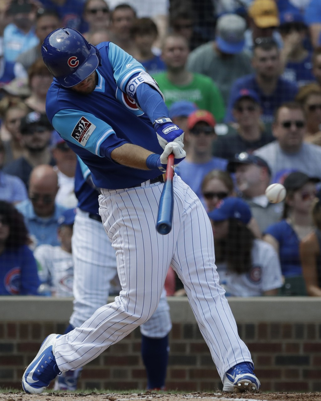 Chicago Cubs' David Bote hits a one-run single against the Cincinnati Reds during the first inning of a baseball game Sunday, Aug. 26, 2018, in Chicag...