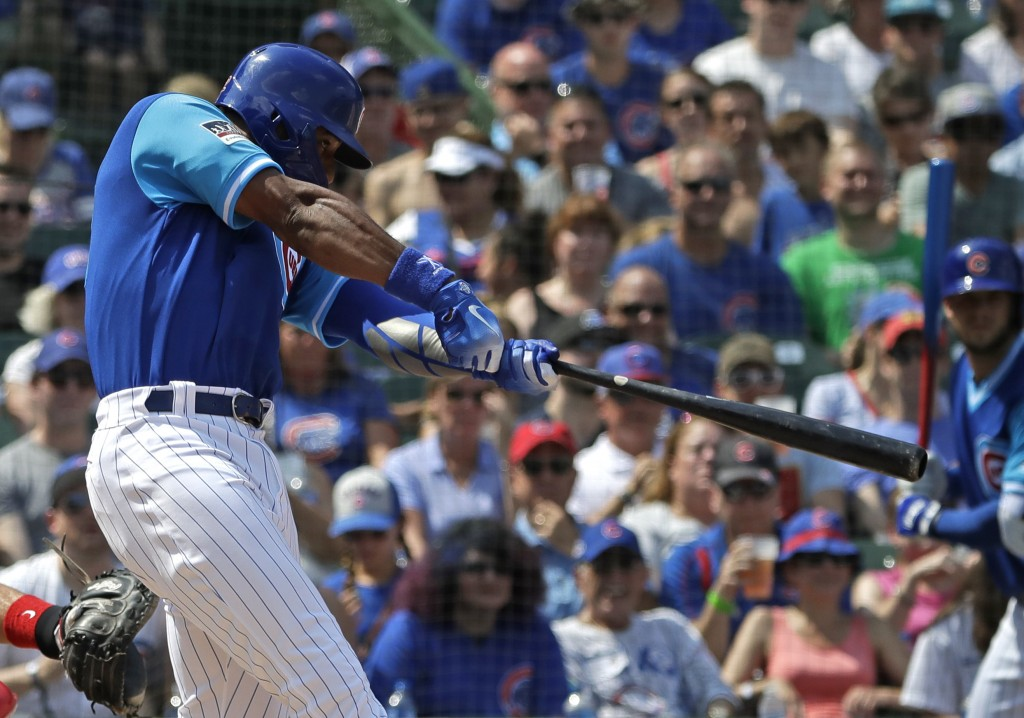 Chicago Cubs' Jason Heyward hits a one-run triple during the first inning of a baseball game against the Cincinnati Reds, Sunday, Aug. 26, 2018, in Ch...