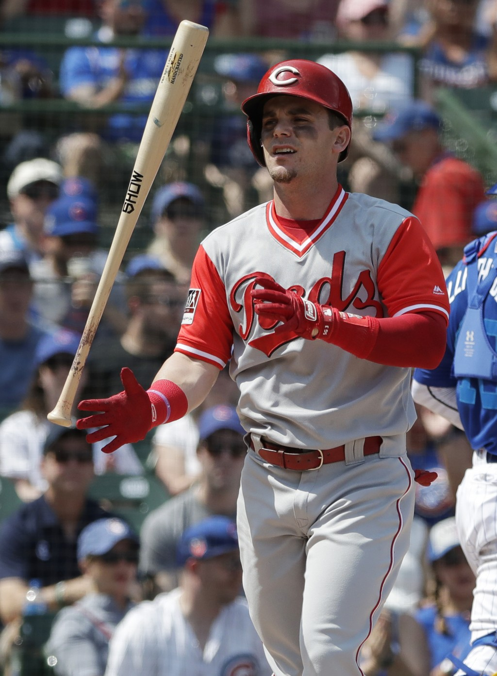 Cincinnati Reds' Scooter Gennett tosses his bat after striking out swinging during the first inning of a baseball game against the Chicago Cubs, Sunda...