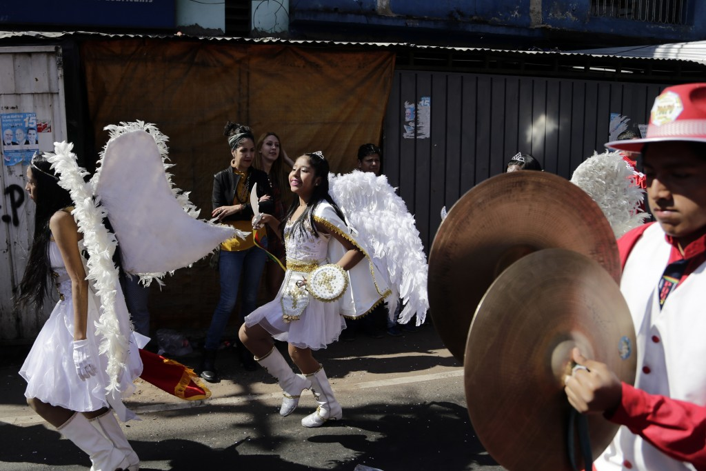 Members of Paraguay's Bolivian community perform in costume during a street procession in honor of Our Lady of Urkupina, in Asuncion, Paraguay, Sunday...