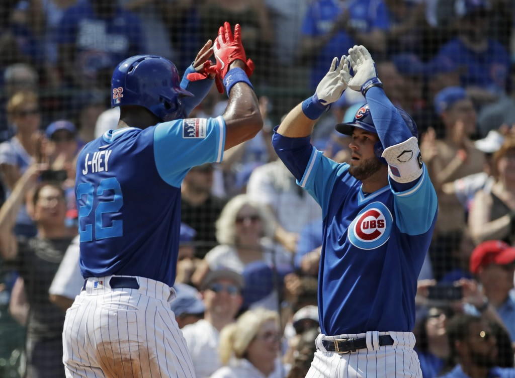 Chicago Cubs' David Bote, right, celebrates with Jason Heyward after hitting a two-run home run during the third inning of a baseball game against the...