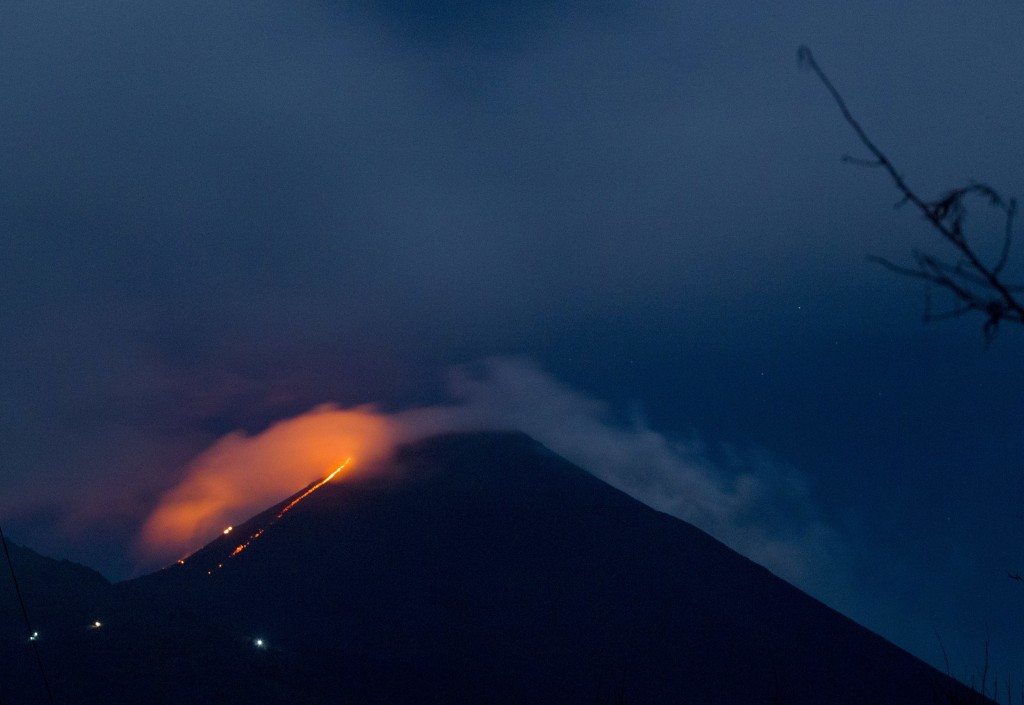 Pacaya volcano spews lava, viewed from San Vicente Pacaya, Guatemala, early Tuesday, Aug. 28, 2018. According to a bulletin published by the Guatemala...