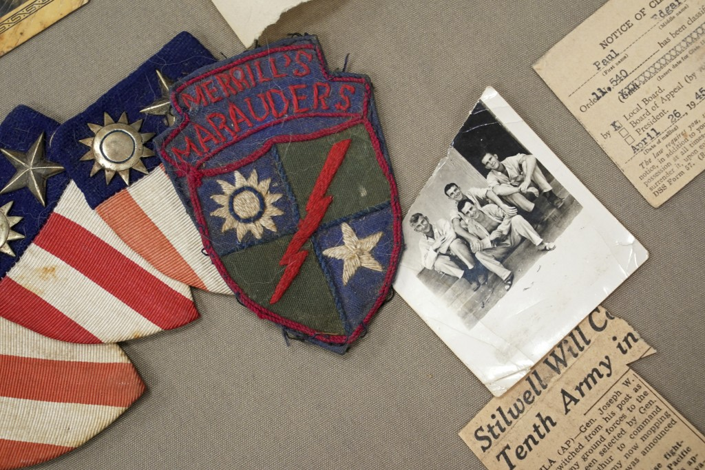 Memorabilia from the famed WWII Army unit Merrill's Marauders is is displayed on a table during a gathering of remaining members, family and history b