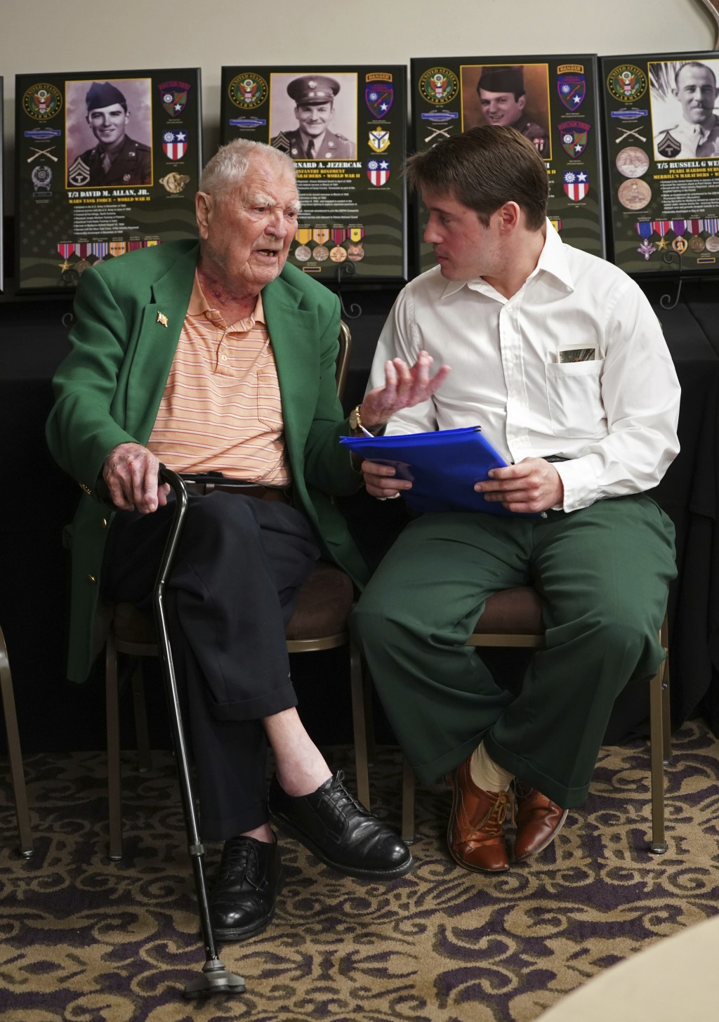 David Allan, of Rockhill SC, left, a surviving members of the famed WWII Army unit Merrill's Marauders talks with Britt Fuller, of Tallahassee Fla., w