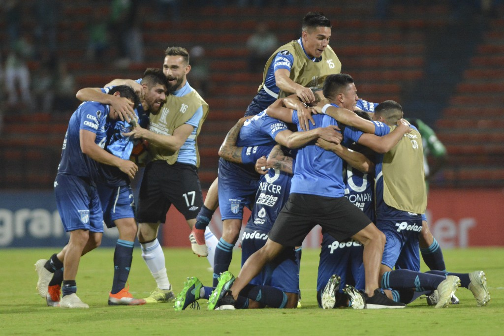 Players of Argentina's Atletico Tucuman celebrate after losing 0-1 against Colombia's Atletico Nacional in a Copa Libertadores round of sixteen soccer...