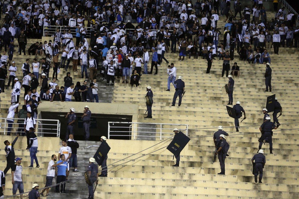 Police order fans of Brazil's Santos to leave the bleachers after fights amid Santos fans broke out at the end of a Copa Libertadores soccer match whi...
