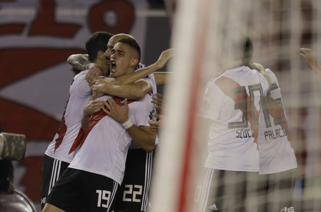 Rafael Borre of Argentina's River Plate, center, celebrates with teammates scoring against Argentina's Racing Club during a Copa Libertadores soccer g...