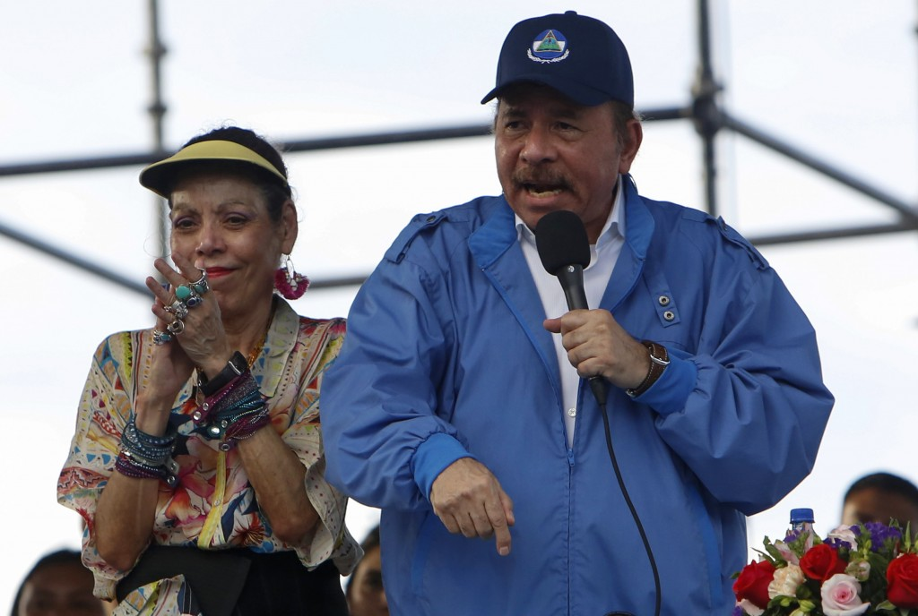 Nicaragua's President Daniel Ortega speaks to supporters as his wife and Vice President Rosario Murillo applauds, in Managua, Nicaragua, Wednesday, Au...