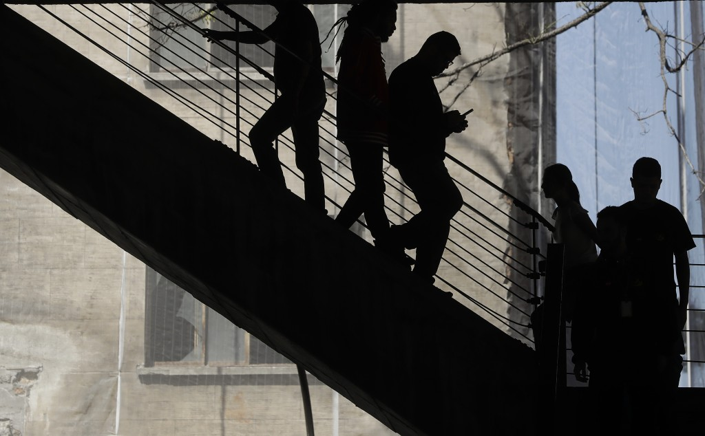 A man checks his mobile phone as he descends stairs in Sao Paulo, Brazil, Tuesday, Aug. 28, 2018. While concern about fake news impacting elections is...