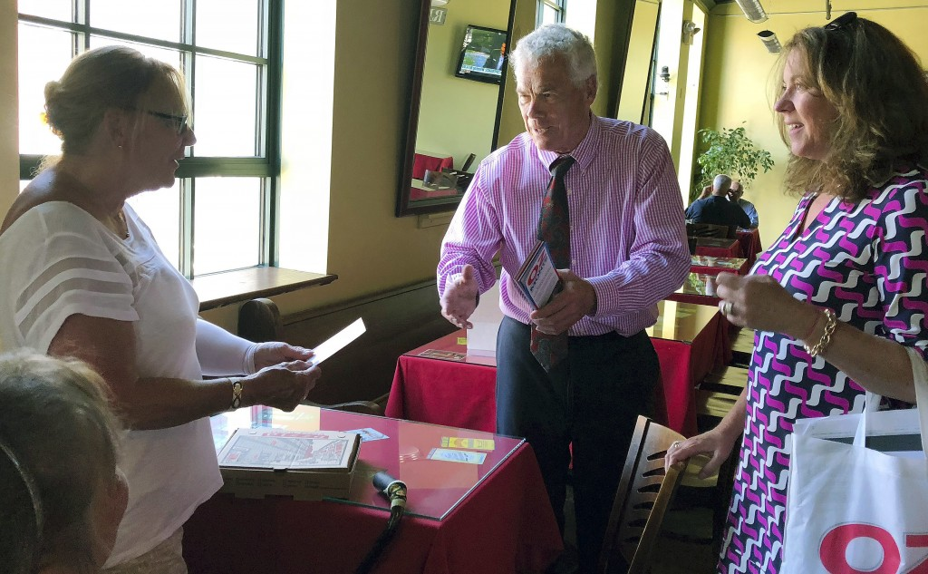 In this July 18, 2018 photo, Oz Griebel, an independent candidate for governor in Connecticut, and his campaign finance director Kate Careb, right, gr