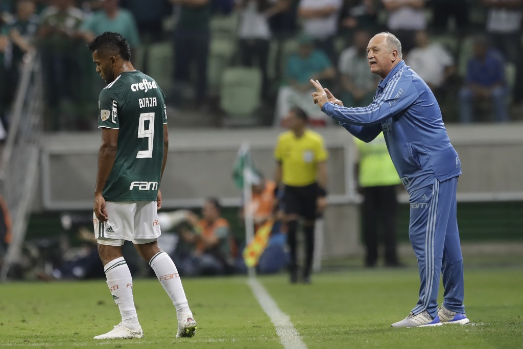 Luis Felipe Scolari, coach of Brazil's Palmeiras, talks to striker Wilson Borja during a Copa Libertadores round of sixteen soccer match against Parag...