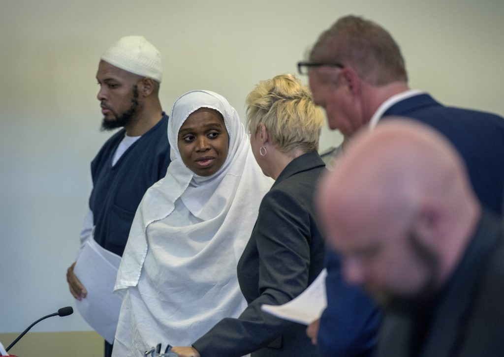 FILE - In this Aug. 29,2018, file photo, Siraj Ibn Wahhaj, from left, and Jany Leveille talk with with attorneys Kelly Golightley and Tom Clark after