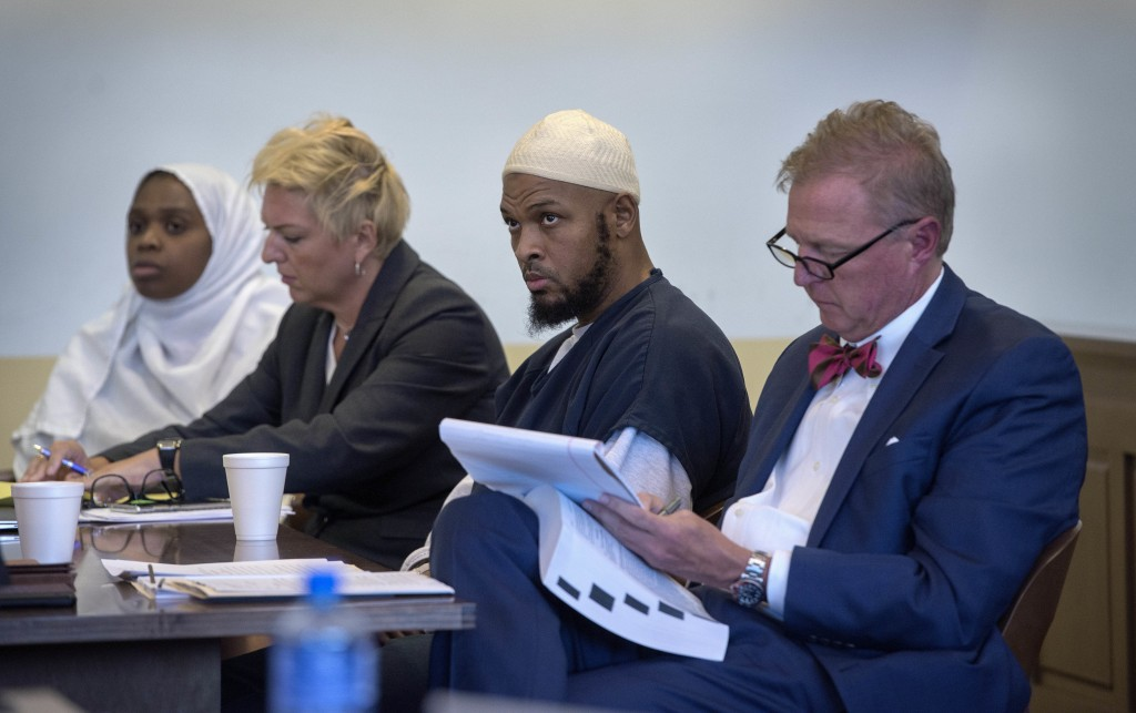 FILE - In this Aug. 29, 2018, file photo, Jany Leveille, from left, with her attorney Kelly Golightley, and Siraj Ibn Wahhaj with attorney Tom Clark l