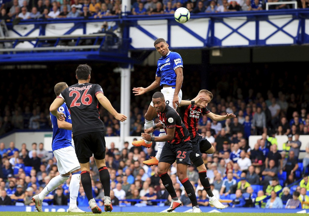 Everton's Dominic Calvert-Lewin heads the ball towards the goal, during the English Premier League soccer match between Everton and Huddersfield Town ...