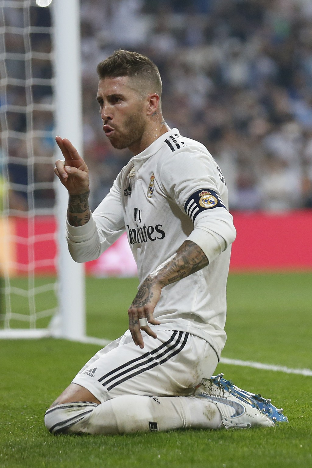 Real Madrid's Sergio Ramos celebrates in front of a TV camera after scoring a penalty and his team's fourth goal during the Spanish La Liga soccer mat