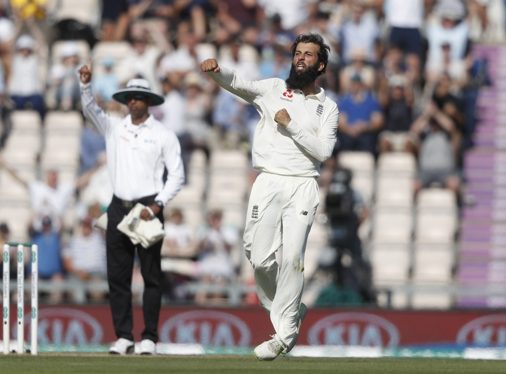 England's Moeen Ali celebrates taking the wicket of India's Virat Kohli caught by England's Alastair Cook during play on the fourth day of the 4th cri...