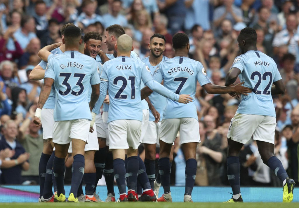 Manchester City's Kyle Walker, left, facing camera, celebrates after scoring his side's second goal during the English Premier League soccer match bet