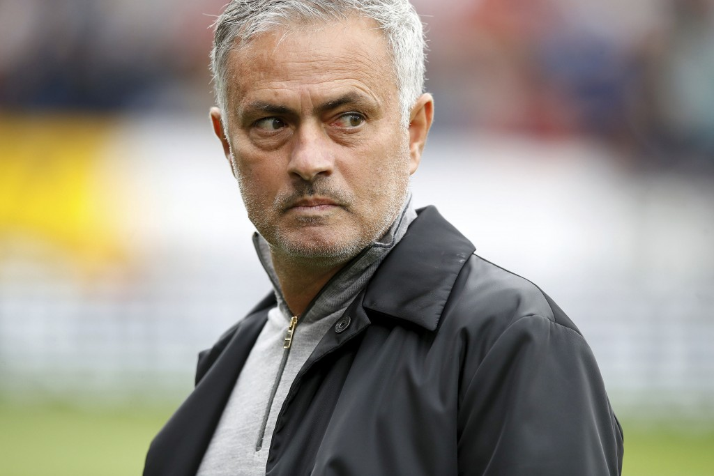 Manchester United manager Jose Mourinho walks on the pitch before a Premier League soccer match between Burnley and Manchester City, at Turf Moor, Bur...