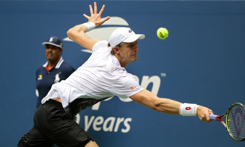 Kevin Anderson of South Africa returns a shot Dominic Thiem of Austria during the fourth round of the U.S. Open tennis tournament Sunday Sept. 2
