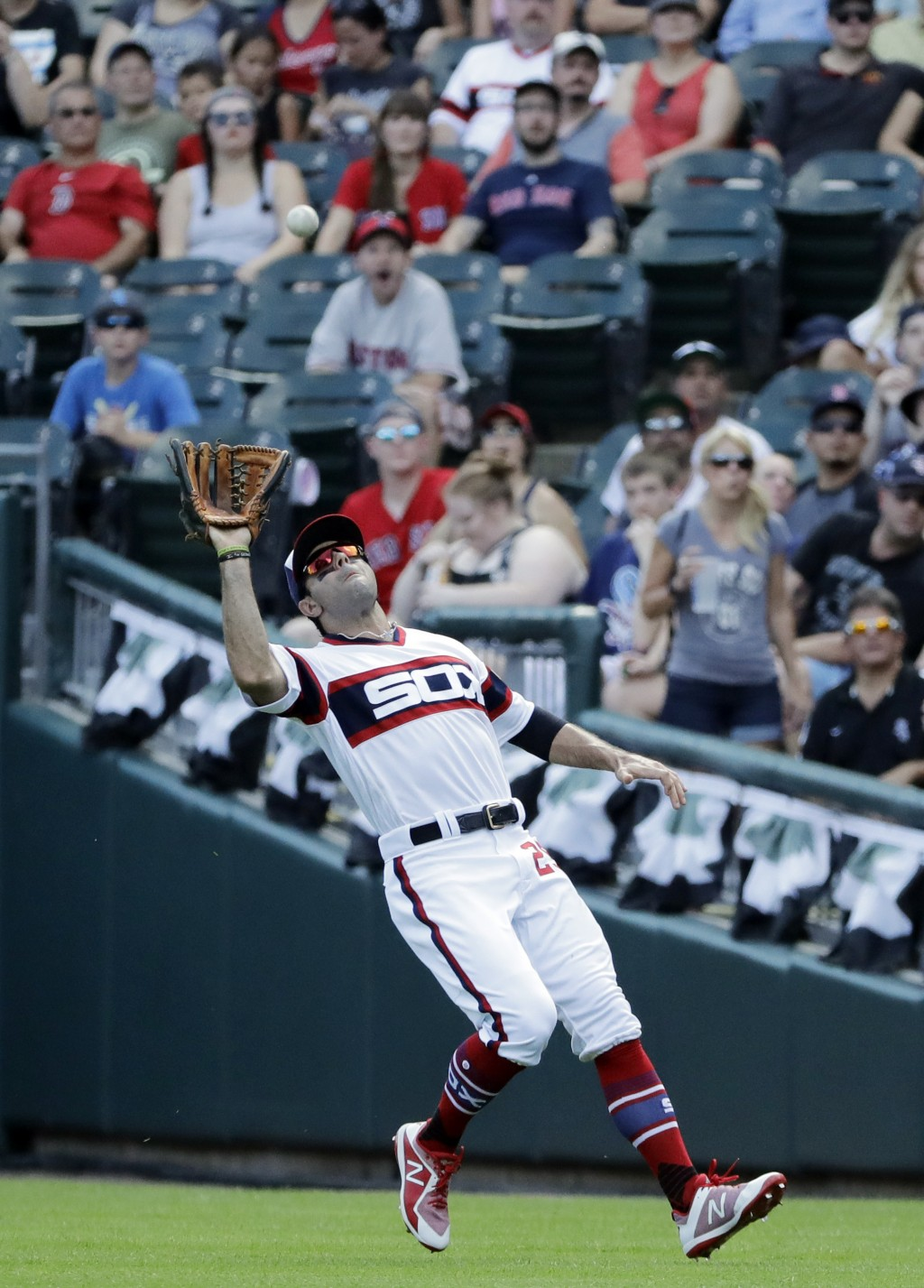 Chicago White Sox right fielder Ryan LaMarre catches a fly ball by Boston Red Sox's Mookie Betts during the first inning of a baseball game Sunday, Se...