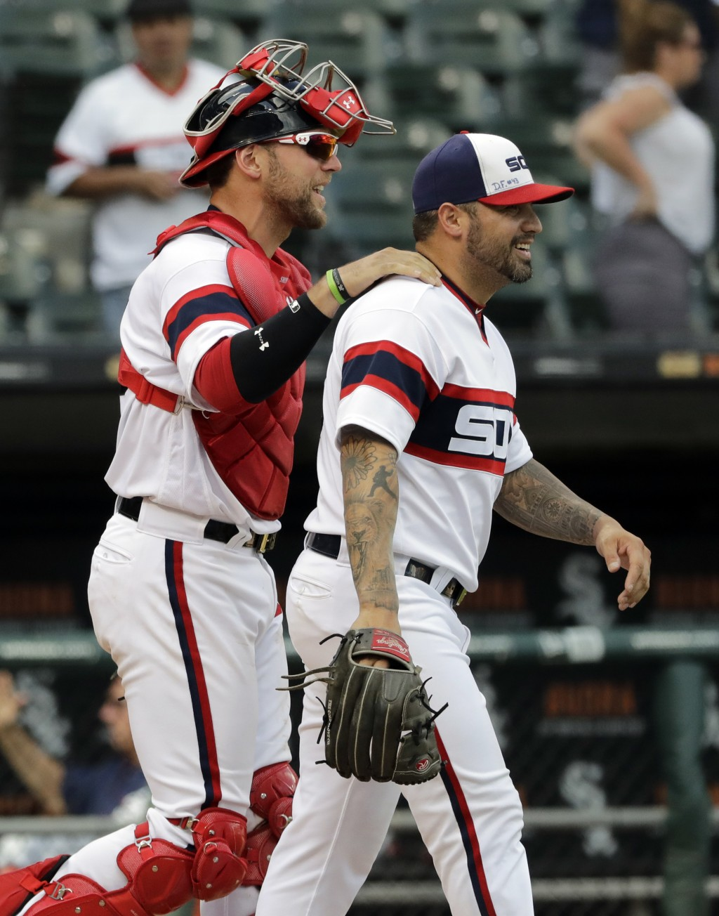 Chicago White Sox relief pitcher Hector Santiago, right, is congratulated by catcher Kevan Smith after the White Sox defeated the Boston Red Sox 8-0 i...