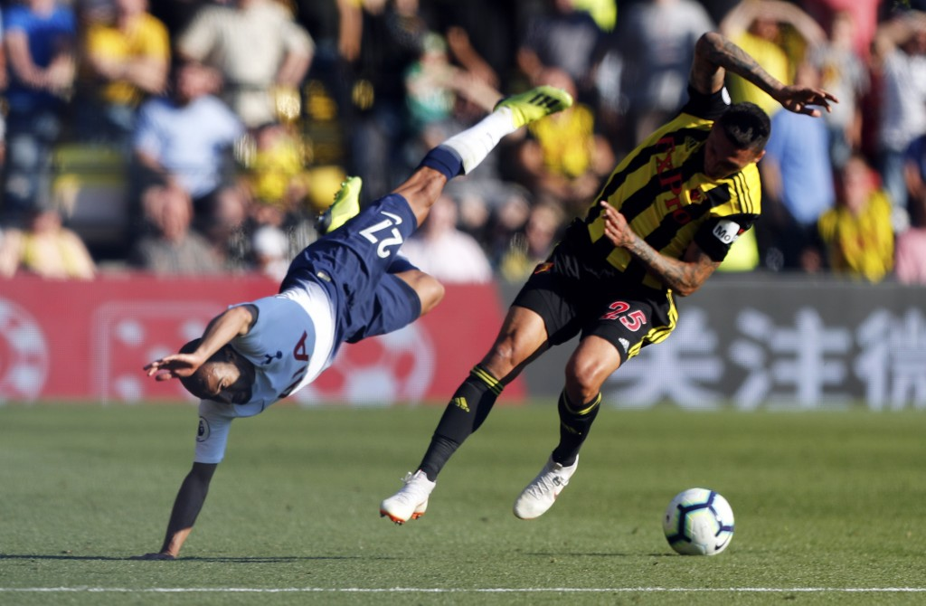 Tottenham's Lucas Moura, left, collides with Watford's Jose Holebas during the English Premier League soccer match between Watford FC and Tottenham Ho