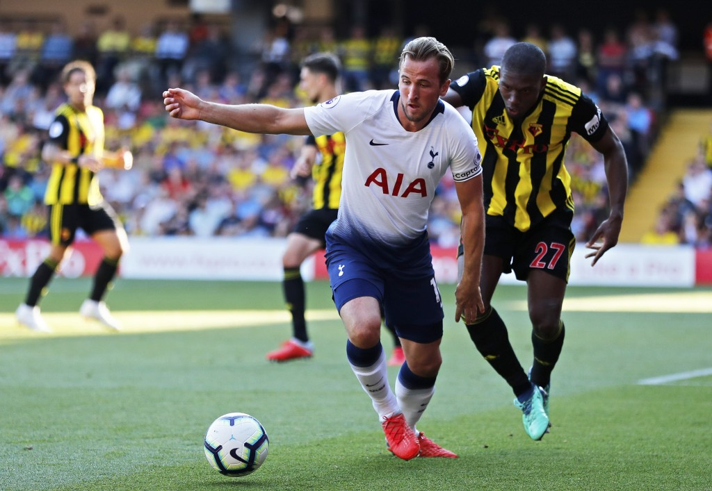 Watford's Christian Kabasele, right, vies for the ball with Tottenham's Harry Kane during the English Premier League soccer match between Watford FC a