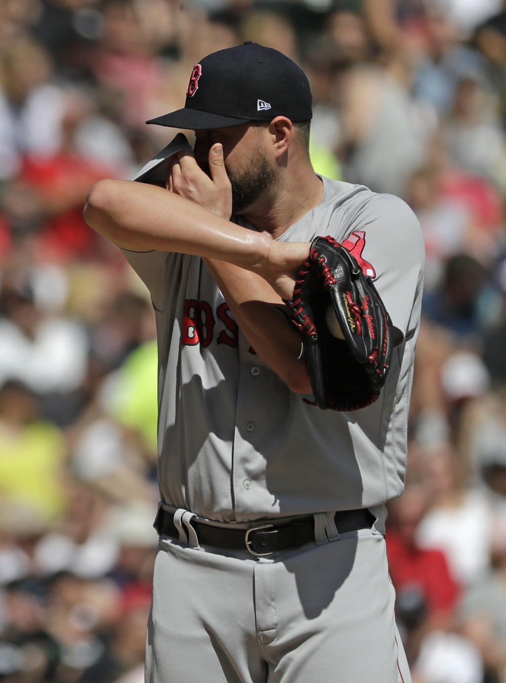 Boston Red Sox starting pitcher Brian Johnson wipes his face during the first inning of a baseball game against the Chicago White Sox, Sunday, Sept. 2...