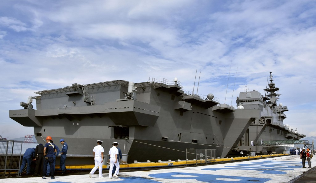 In the Sept. 1, 2018 photo, Japan's helicopter carrier J JS Kaga stops at Subic port in Zambales province, the Philippines.  The Japanese navy's large
