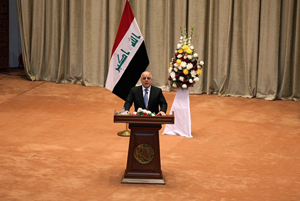 Iraq Prime Minister Haider al-Abadi addresses a newly elected parliament during its first session in Baghdad, Iraq, Monday, Sept. 3, 2018. Iraq's newl