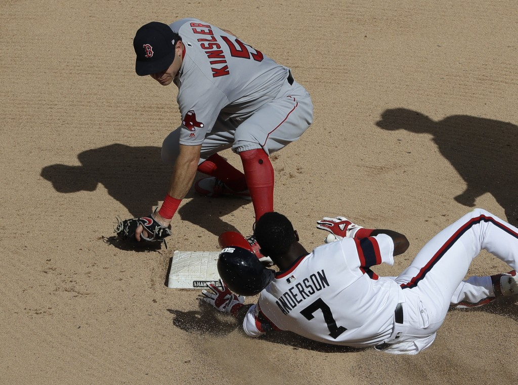 Chicago White Sox's Tim Anderson (7) slides safely into second base after hitting a double as Boston Red Sox second baseman Ian Kinsler applies a late...