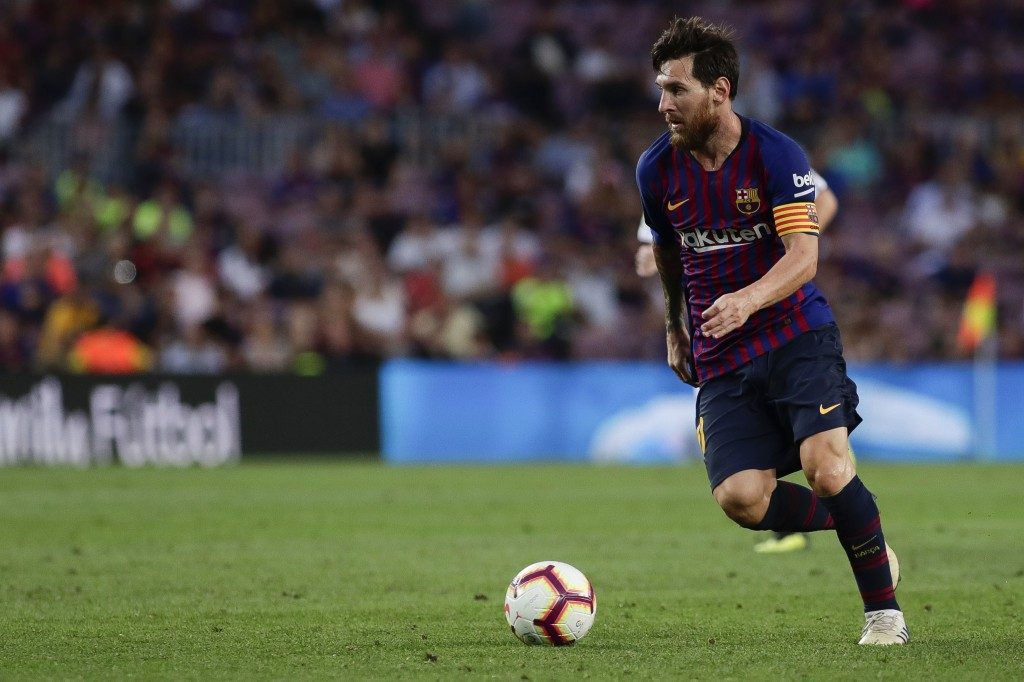 Barcelona's Lionel Messi controls the ball during a Spanish La Liga soccer match between Barcelona and Huesca at the Camp Nou stadium in Barcelona, Sp
