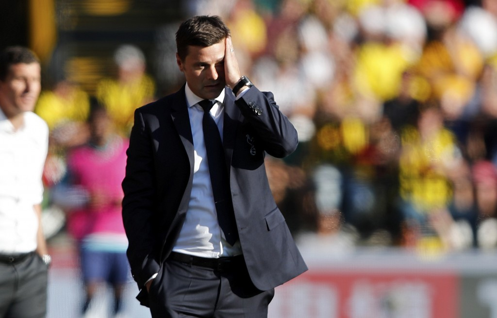 Tottenham manager Mauricio Pochettino reacts after Watford scored their first goal during the English Premier League soccer match between Watford FC a...