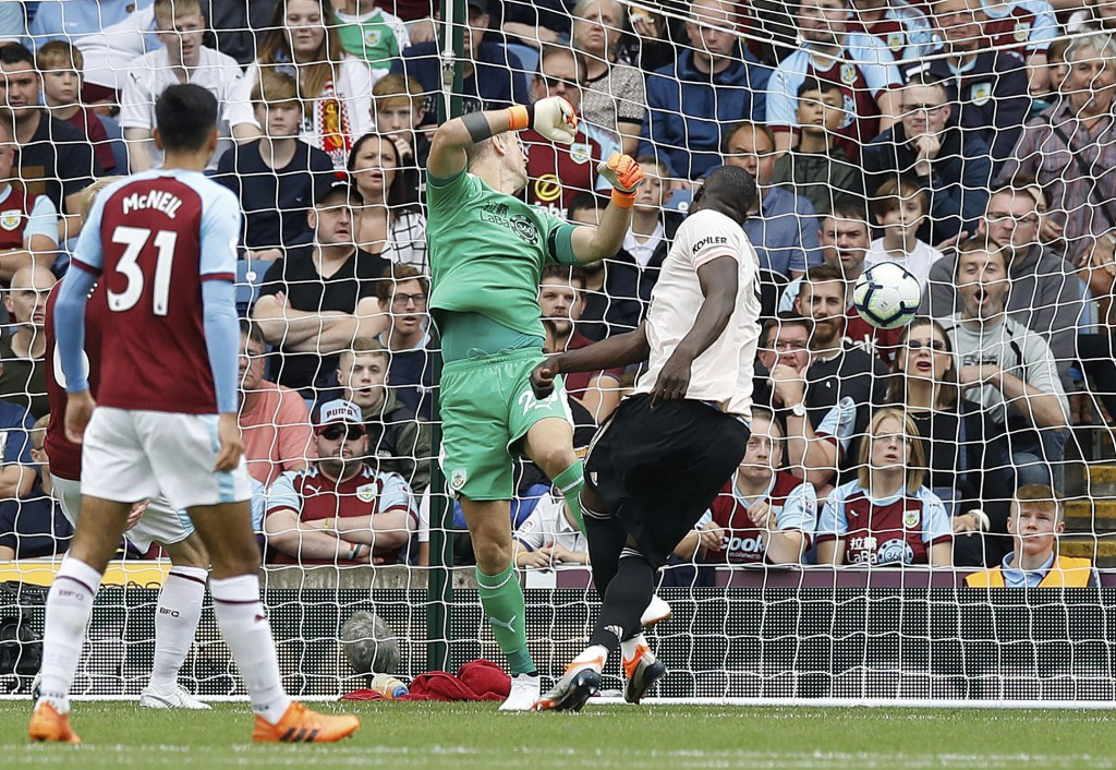 Manchester United's Romelu Lukaku scores his side's first goal during the Premier League match against Burnley, at Turf Moor, Burnley, England, Sunday...