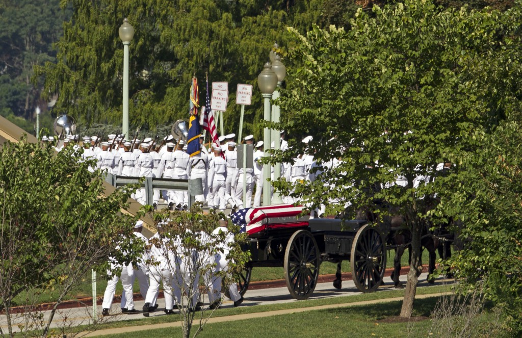 A horse drawn caisson carries the casket containing the remains of Sen. John McCain, R-Ariz., to his burial sight at the United States Naval Academy C