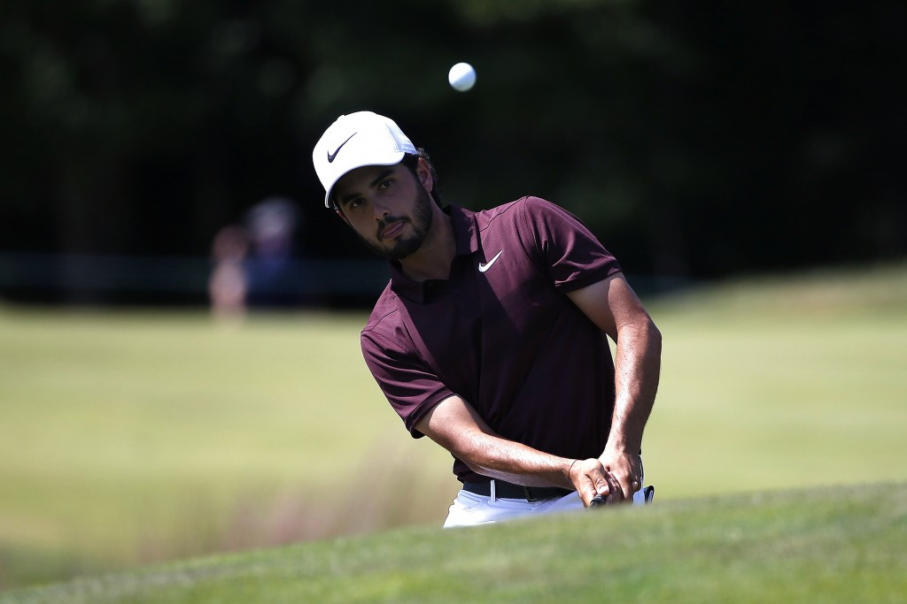 Abraham Ancer chips onto the second green during the third round of the Dell Technologies Championship golf tournament at TPC Boston in Norton, Mass.,...