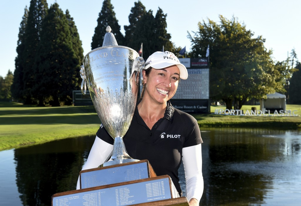 Marina Alex holds the trophy after winning the LPGA Cambia Portland Classic golf tournament in Portland, Ore., Sunday, Sept. 2, 2018. (AP Photo/Steve