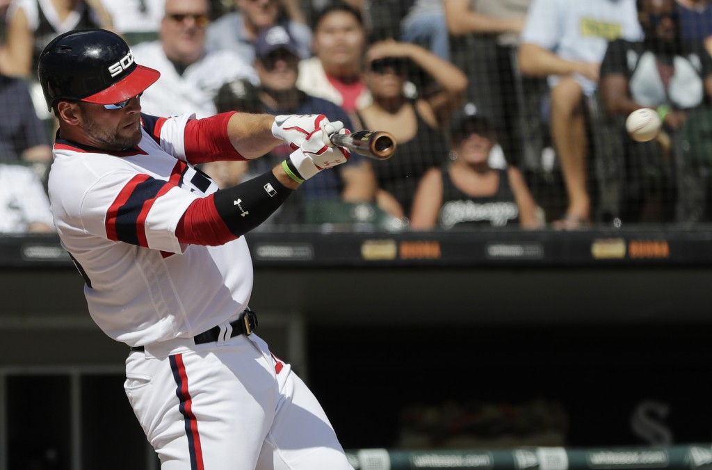 Chicago White Sox's Kevan Smith hits a one-run single during the first inning of a baseball game against the Boston Red Sox, Sunday, Sept. 2, 2018, in...