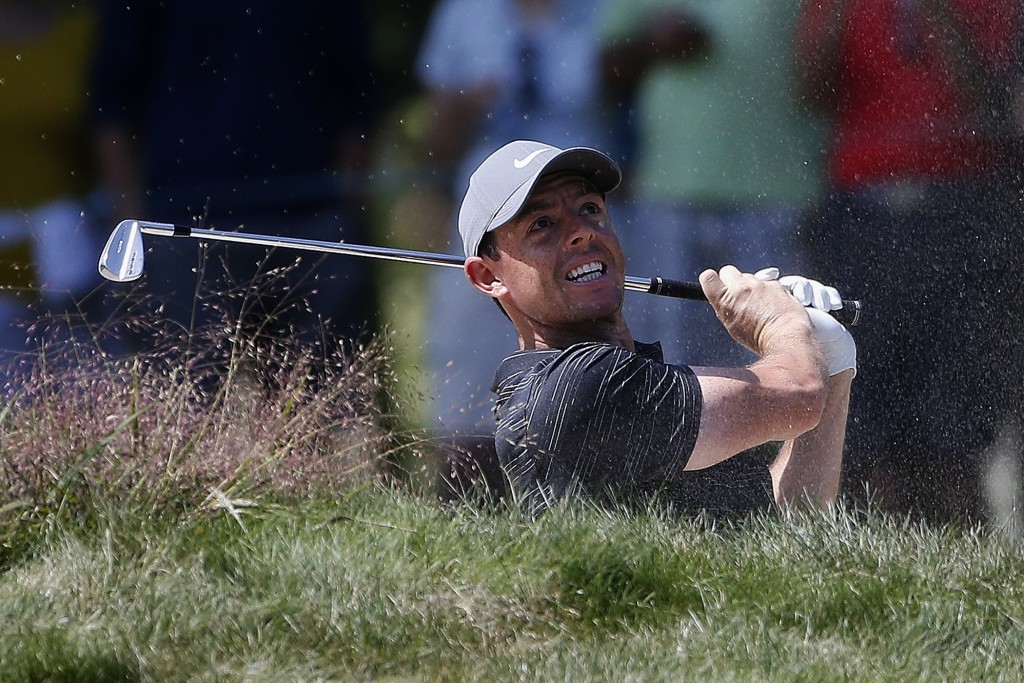 Rory McIlroy hits out of a bunker on the fifth hole during the third round of the Dell Technologies Championship golf tournament at TPC Boston in Nort...