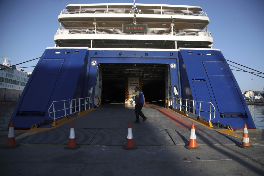 A ferry is docked during the second day of seamen's union's strike at a port of Piraeus, near Athens, Tuesday, Sept. 4, 2018. Greek ferry crews on Mon...