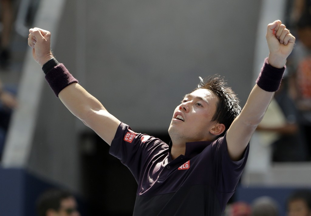 Kei Nishikori, of Japan, celebrates after defeating Philipp Kohlschreiber, of Germany, during the fourth round of the U.S. Open tennis tournament, Mon...