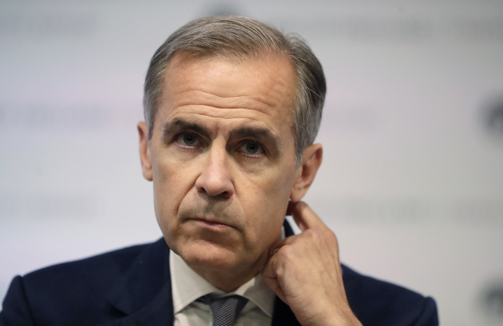 FILE - In this file photo dated Wednesday, June 27, 2018, Mark Carney the Governor of the Bank of England, during a press conference to deliver the Fi