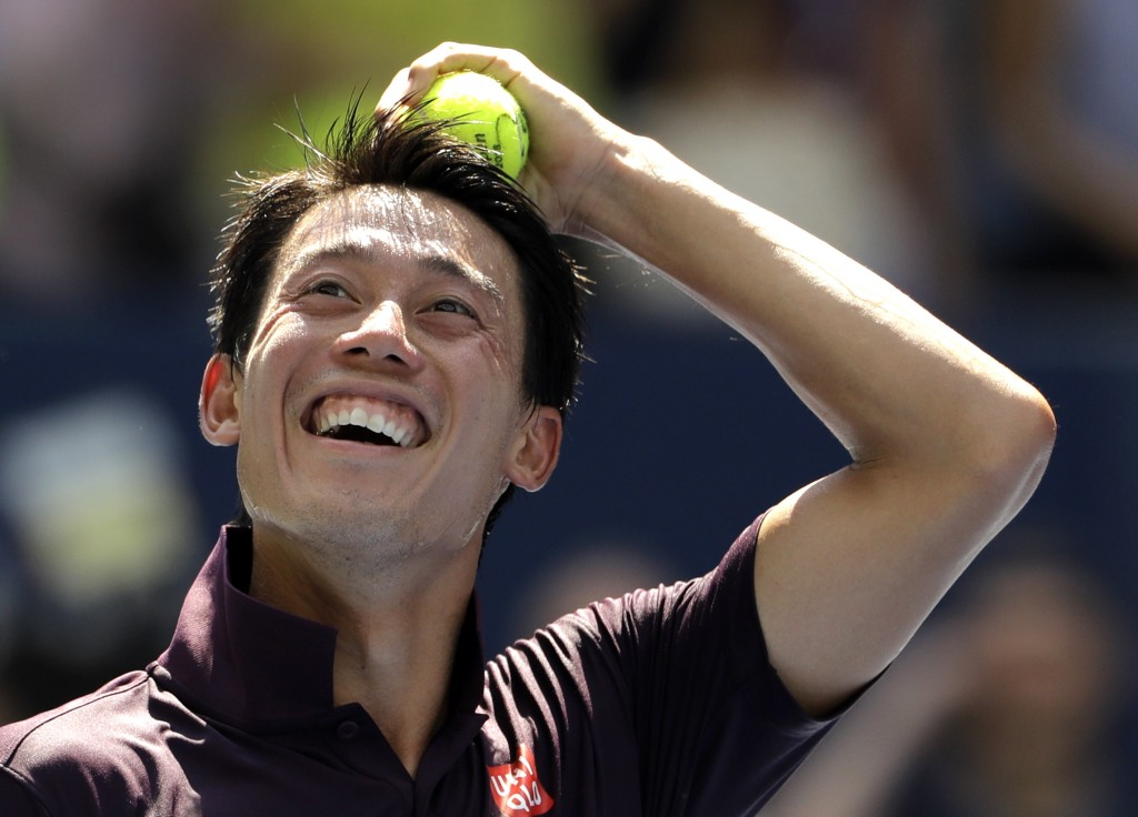 Kei Nishikori, of Japan, smiles after defeating Philipp Kohlschreiber, of Germany, during the fourth round of the U.S. Open tennis tournament, Monday,...