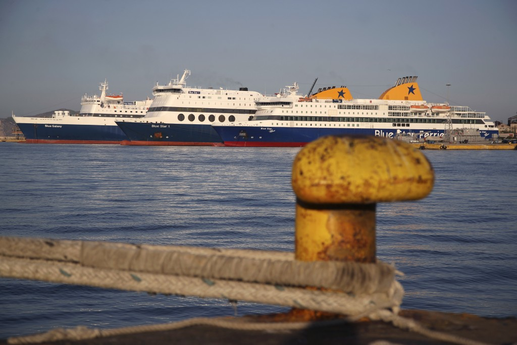 Ferries are docked during the second day of seamen's unions' strike at a port of Piraeus, near Athens, Tuesday, Sept. 4, 2018. Greek ferry crews on Mo...
