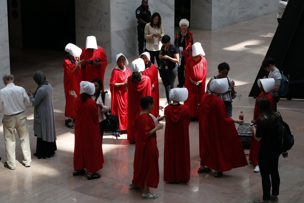 """Demonstrators protesting against Supreme Court nominee Brett Kavanaugh, wear costumes from the show """"The Handmaid's Tale,"""" during his confirmation hea..."""