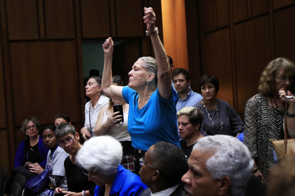 A protester gestures as she voices out her objection during a Senate Judiciary Committee nominations hearing on Supreme Court nominee Brett Kavanaugh,...