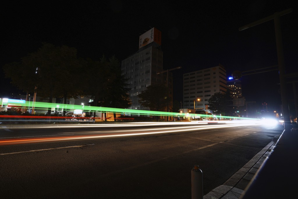 Cars pass by in the blackout on the center of Sapporo city, Hokkaido, northern Japan, Thursday, Sept. 6, 2018. A powerful earthquake hit wide areas on