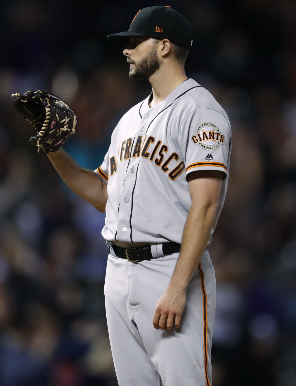San Francisco Giants starting pitcher Andrew Suarez waits for a new ball after giving up a solo home run to Colorado Rockies' Trevor Story during the ...