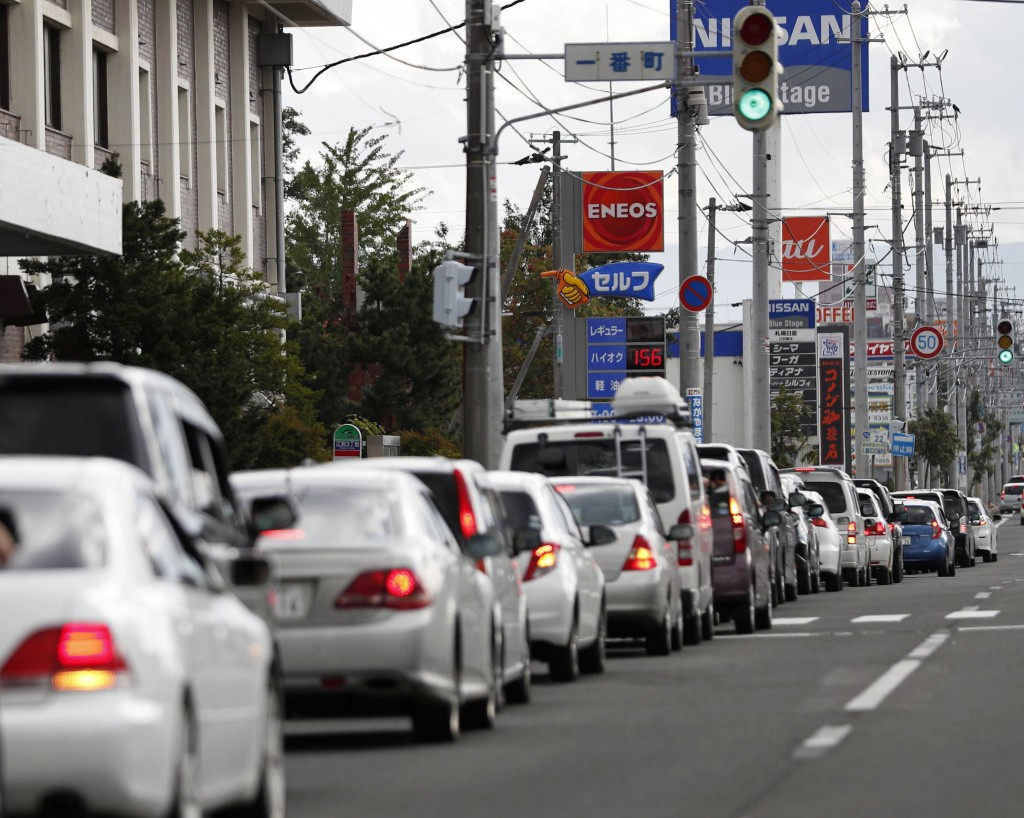 Cars are queued up as drivers wait to buy gas after an earthquake in Ebetsu, Hokkaido, northern Japan, Thursday, Sept. 6, 2018. A powerful earthquake