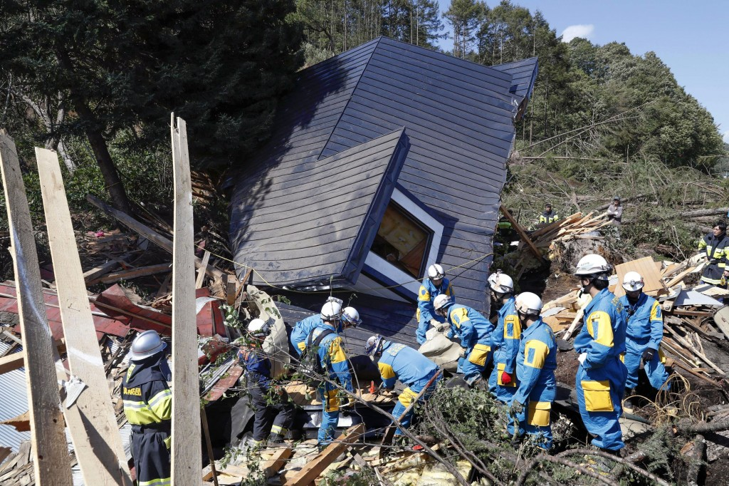 Police search for missing persons around a house destroyed by a landslide after a powerful earthquake in Atsuma town, Hokkaido, northern Japan, Thursd